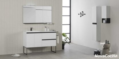 mueble de lavabo en tonos blancos con decoraciones en negro